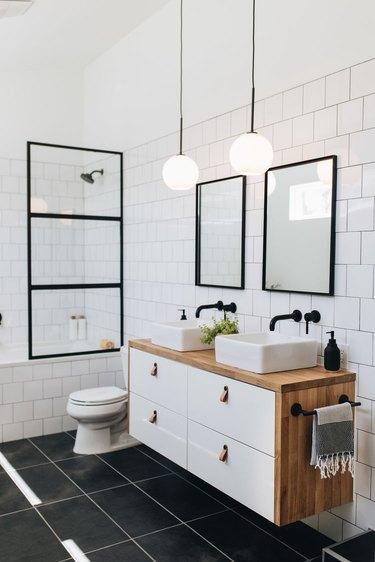 Black tile minimalist flooring in modern black and white bathroom