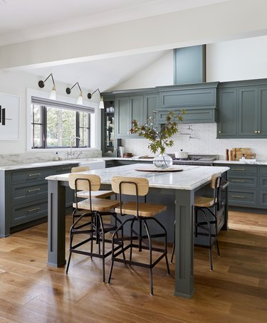simple kitchen island decor with foliage clipping in kitchen with green cabinets