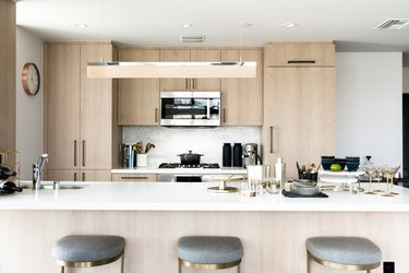 kitchen island decor with bar accessories in kitchen with light wood cabinets