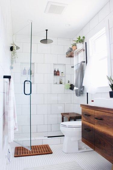 shower storage ideas in modern bathroom with walk-in shower