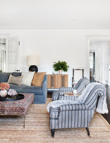 farmhouse style living room with indigo patterns and jute rug