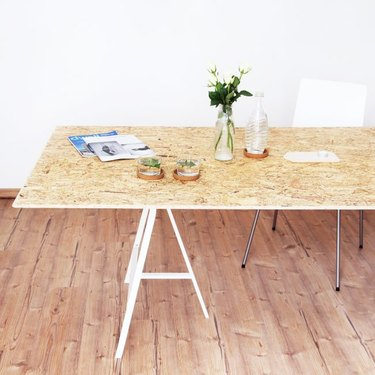 DIY minimalist dining table in plywood with simple white legs