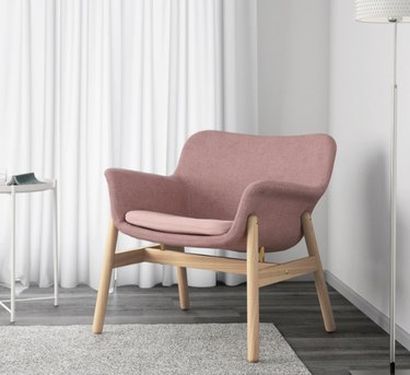 IKEA living room minimalist furniture in living room with pink accent chair