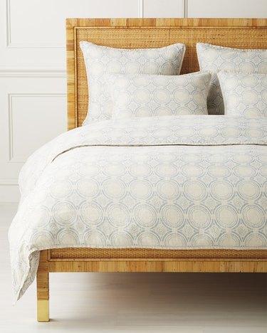 blue and white patterned duvet