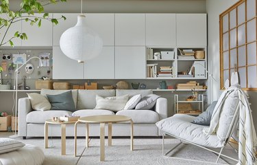 IKEA living room minimalist furniture in beige living room with with white storage cupboards