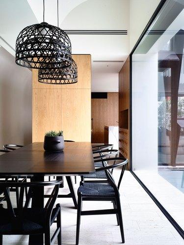 minimalist dining room idea with black furniture and lighting