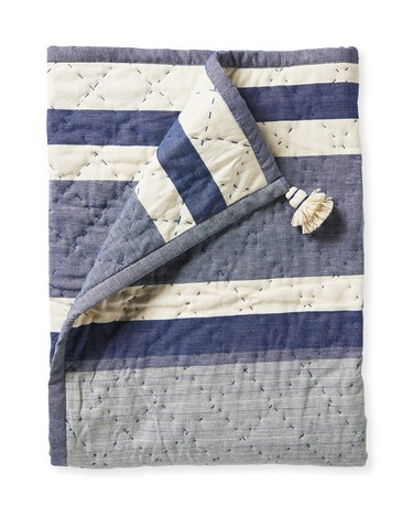 blue and white striped quilt