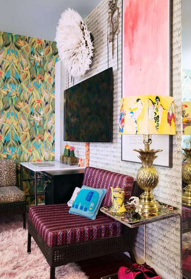 pattern filled living room with ornate lamp and tropical wallpaper