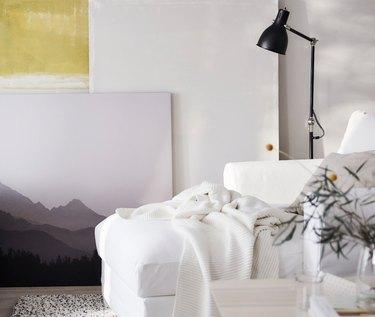 IKEA living room minimalist furniture with modern art and black floor lamp