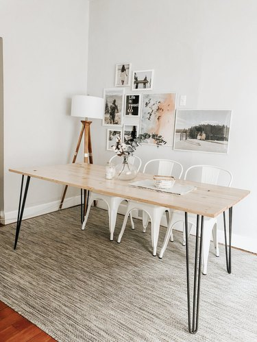 DIY minimalist dining table with wood top and metal hairpin legs