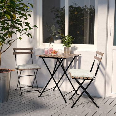 white minimalist balcony idea with table and two chairs
