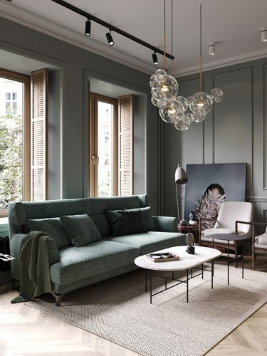 glamorous industrial living room idea with glass ceiling fixture