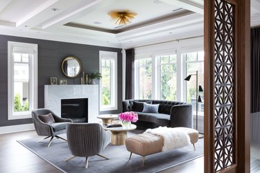 living room mirror ideas above fireplace against gray wall