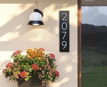 modern house numbers on metal plaque