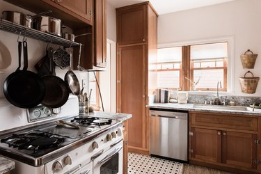 best gas stove in kitchen with tile floor and wood cabinets