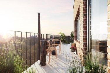 long minimalist balcony idea with table and plants