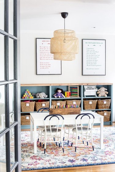 Minimalist toy storage idea with labeled storage baskets in playroom