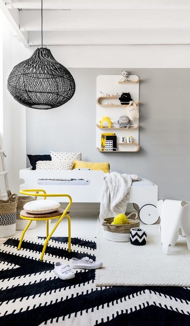 minimalist toy storage idea with shelving in black and white bedroom