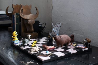 Black and white chessboard with various creatures