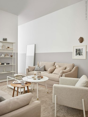 living room mirror ideas with leaning mirror and color block wall