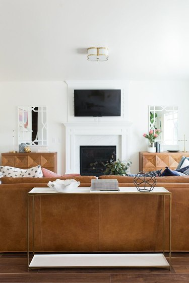 living room mirror ideas with brown leather sofa