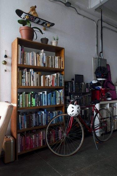 Bookshelves and bike in loft