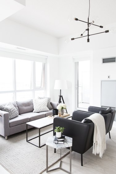 Living room lighting idea with black and white color palette