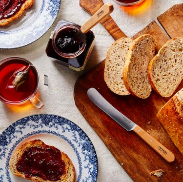 view of brunch foods with knife and sliced bread