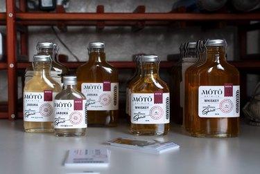 MÔTÔ SPIRITS bottles on white counter