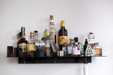 Floating shelf with various liquor bottles