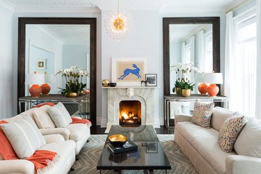 small living room idea with fireplace and two floor to ceiling mirrors