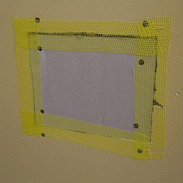 Drywall patch, taped.