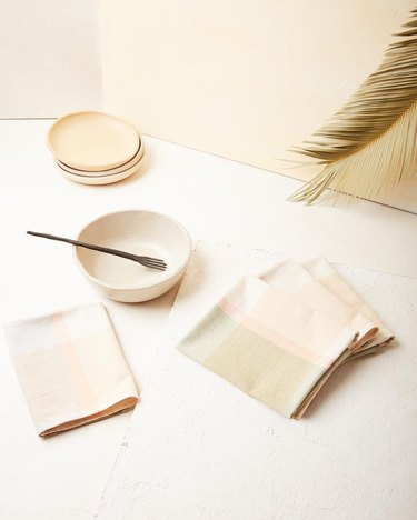 napkins near dinnerware in pastel colors