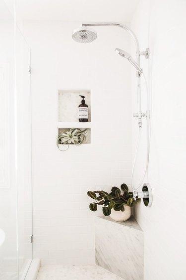 white shower storage ideas with marble corner ledge