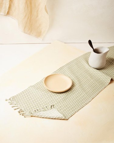 table runner in light green color with dinnerware