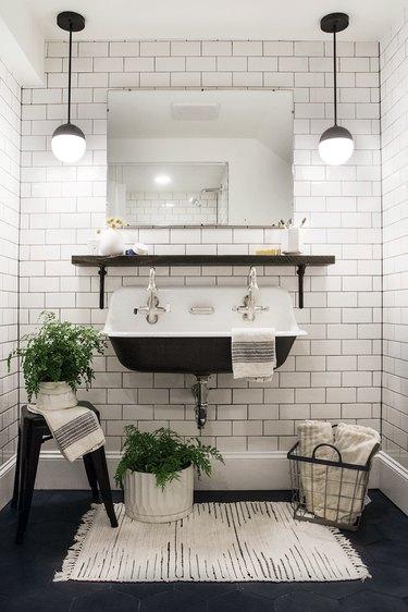 bathroom rug idea in black and white industrial bathroom