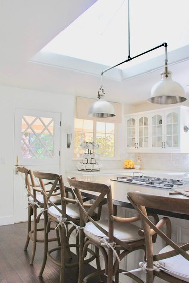 Kitchen island with stove and wood seating