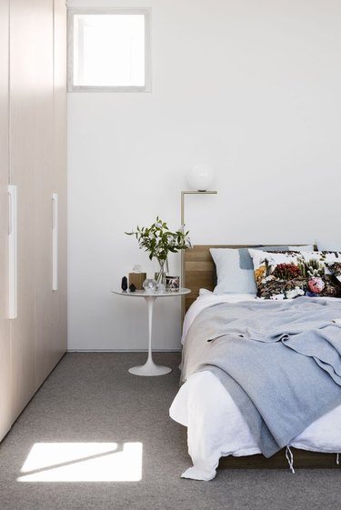 minimalist with color in white room with bed
