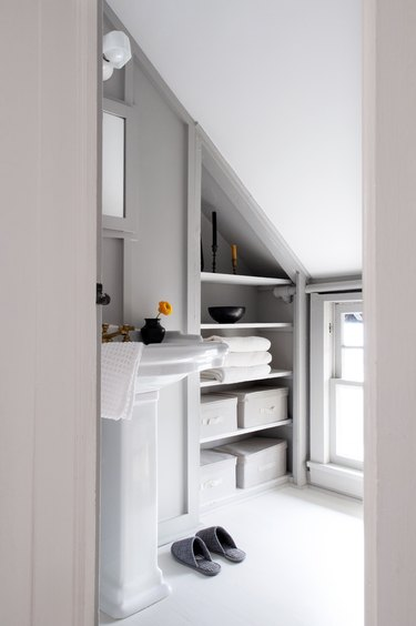 bathroom storage and slanted ceiling
