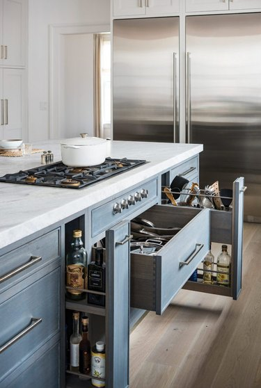 Kitchen island with stove and blue storage drawers