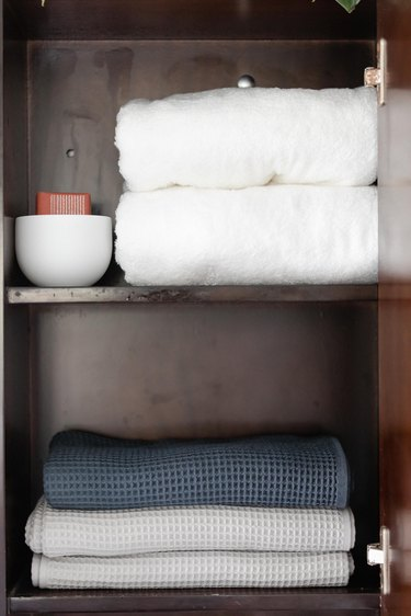 bathroom cabinet storage and towels