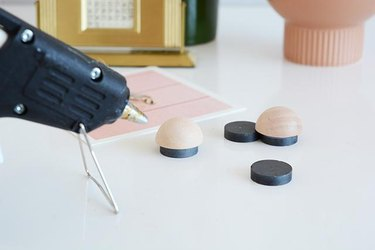 Glue magnets to wooden discs