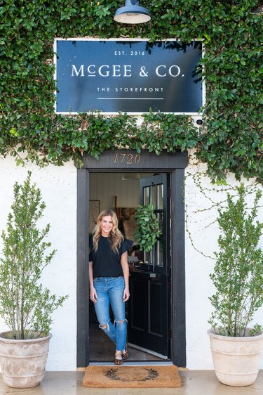 Shea from Studio McGee standing in door way of storefront