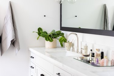 white bathroom vanity cabinet, stone vanity countertop, sink and wall mirror