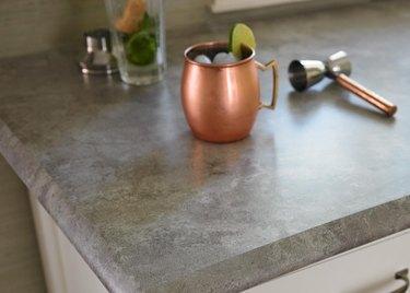Corner of laminate countertop with molded edge.