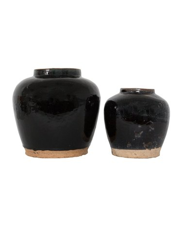 Two black ceramic jars