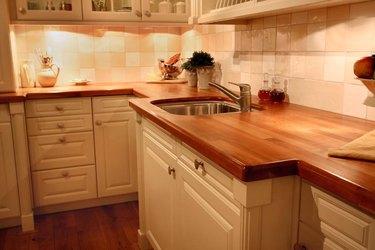 Kitchen corner with butcher block counters.