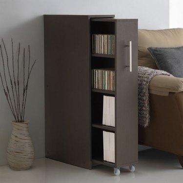 family room storage with hiding shelf