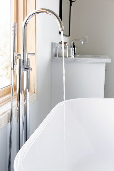 running high-arc faucet and stand-alone tub