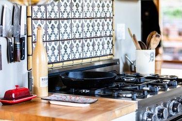 kitchen range with decorative tile backsplash